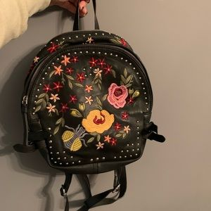 Embroidered vegan leather backpack